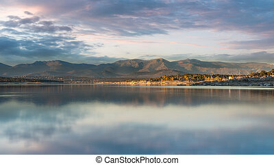 Afternoon in the lake - Lake surrounded by hills on an...