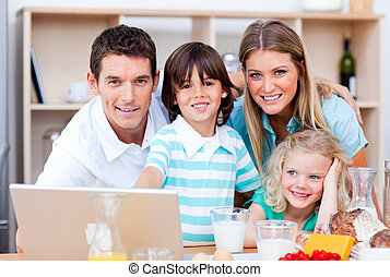 Jolly family using laptop
