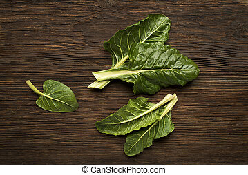 Chard - Fresh swiss chard leaves on a wooden background