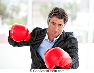 Cute businessman with boxing gloves