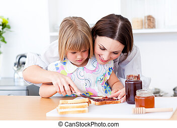 Caucasian mother explain her daughter how to prepare a meal