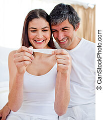 Adorable couple concentrated together at home