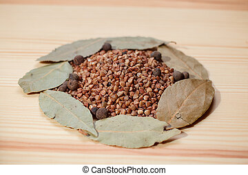 buckwheat and bay leaf on wooden table