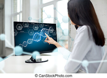 close up of woman with dna molecule on computer - people,...