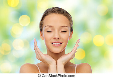 smiling young woman face and hands - beauty, people,...