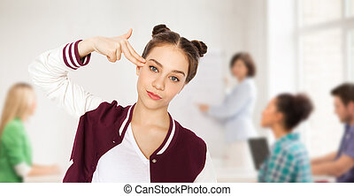 bored student girl making finger gun gesture - people,...