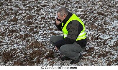 Farmer on frozen field