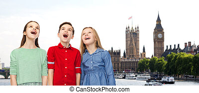 amazed boy and girls looking up over london
