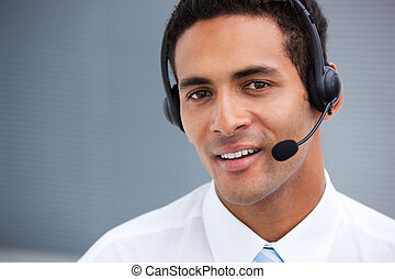 Portrait of a handsome customer service agent at work in a...