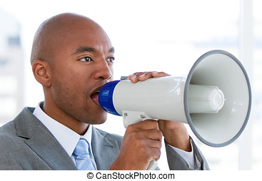 Competitive businessman yelling through a megaphone -...