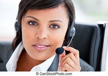 Portrait of a charming customer service agent at work in the...