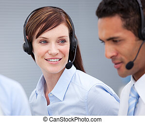 Close-up of a female customer service agent and hercolleague...