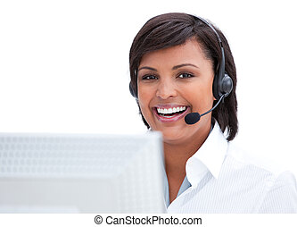 Portrait of a smiling customer service agent working at a...