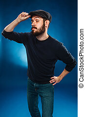 The inquisitive man - The inquisitive young man in cap on...
