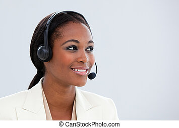 Portrait of an Afro-american businesswoman with headset on -...
