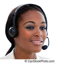 Portrait of an ethnic businesswoman with headset on against...