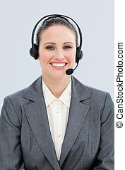 Portrait of an attractive businesswoman with headset on in a...