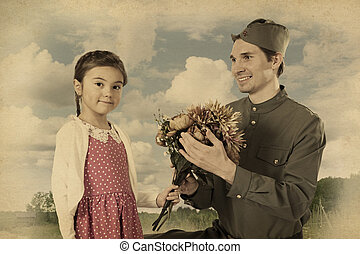 Little girl giving bunch of flowers to Soviet soldier