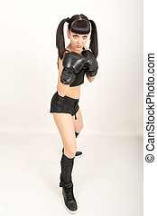 female boxer, fitness woman boxing wearing boxing black gloves