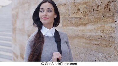 Confident young woman leaning against wall - Confident young...