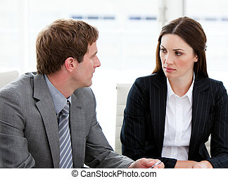 Two concentrated business people talking together in a...