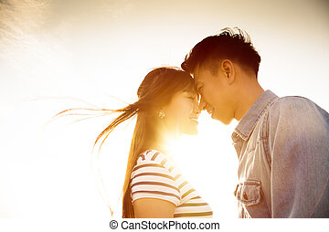 Smiling Couple in love with sunlight background