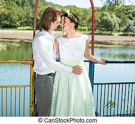couple ,love hug in forest tree blue lake outdoors