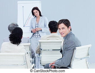 Confident businessman at a presentation with his colleagues