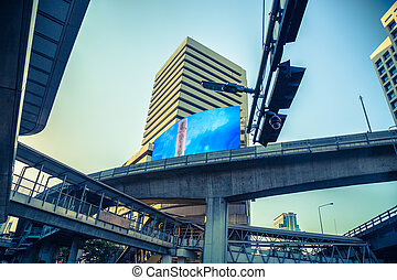 Bangkok Silom Road junction with Skytrain