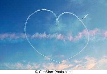 Blue sky heart - A smoke trail heart written against a blue...