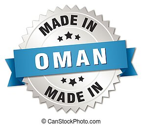 made in Oman silver badge with blue ribbon