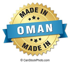 made in Oman gold badge with blue ribbon