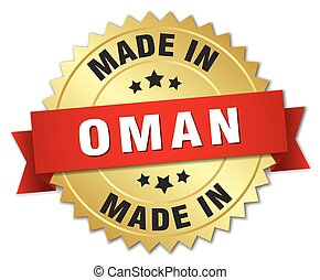 made in Oman gold badge with red ribbon