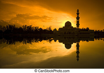 mosque - silhouette of a moque during sunset