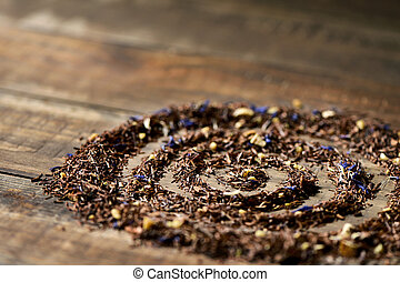 rooibos mixed with flowers, dry fruits and herbs - closeup...