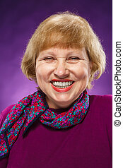 Old age woman laughing on lilac background