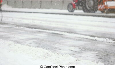 Blizzard covering frozen streets with snow fall - People...