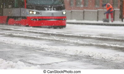Tram arriving to the frozen platform during storm - Streets...