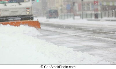 Cleaning car plowing snow to side of the street - Plowing...