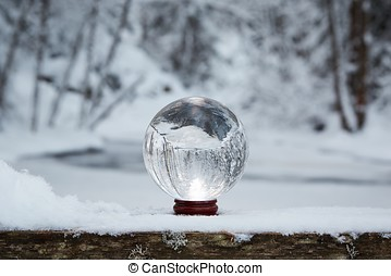 Crystal ball in the winter - Winter scene with a transparent...