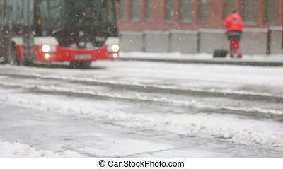 Bus arriving to the frozen platform during storm - Streets...