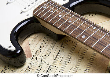 Electric Guitar - Black and white electric guitar is in the...