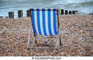 Desolate deckchair - An empty deckchair on the shingle beach...