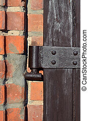 Antique door hinge closeup - Old door hinge on wooden door...