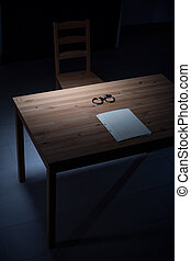 Desk in interrogation room - Image of empty desk with...