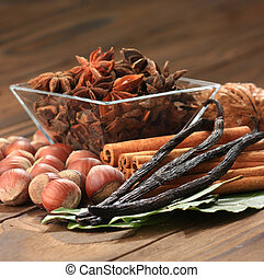 vanilla, - closeup of anise, cinnamon and vanilla pods on...