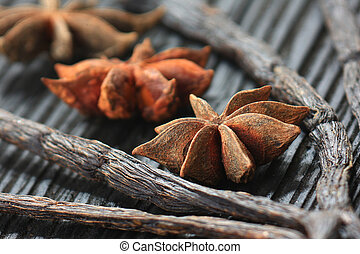 vanilla, anisetree - closeup of anise, and vanilla pods on...