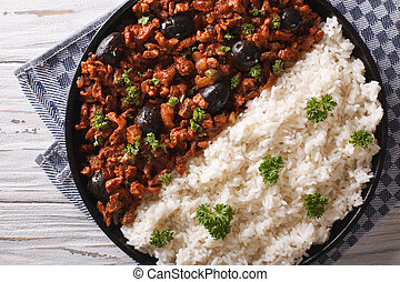 Cuban Picadillo a la habanera with rice close-up. horizontal...