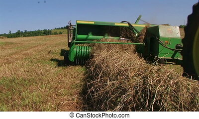 Square Baling Hay 03 - Square baling hay with accumulator,...