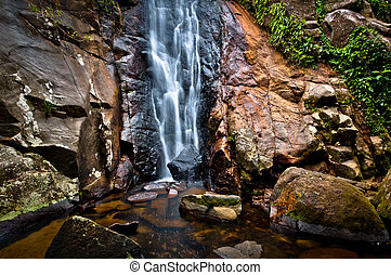 Small Waterfall in Tropical Rainforest in an Island in...